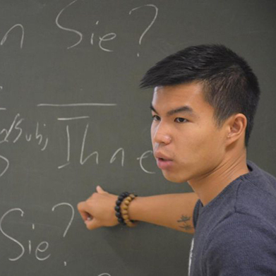 AJY student at chalkboard