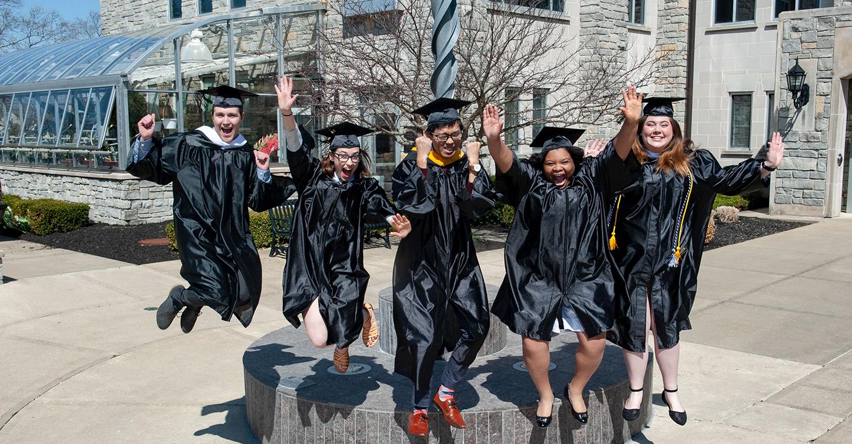 Graduates jumping